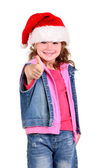 Little girl in denim suit and a hat of Santa Claus — Stock Photo