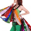 Female hand holding colorful shopping bags — Stock Photo