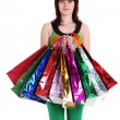 Female hand holding colorful shopping bags — Stock Photo #6224917