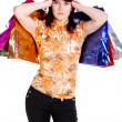 Womlooking puzzled while choosing whilst shopping — Stockfoto #6361526