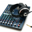 图库照片: Mixing console and headphones.