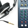 Mixing console and headphones — 图库照片