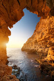 Sunset into grotto — Stock Photo