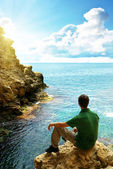 Man in sea cave. — Stock Photo