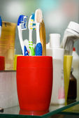 Colorful toothbrushes in a glass — Stock Photo