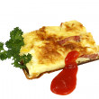 Omelet with ham and parsley — Stock Photo