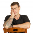 Portrait sleeping on a chair young men — Stock Photo