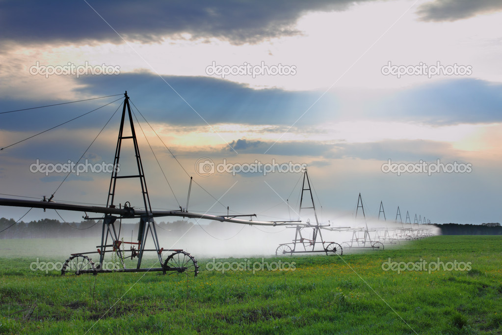 Landscape with automatic irrigation of agriculture field — Stock Photo #5688946