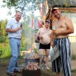 Outdoor party - preparing shashlik — Stock Photo #5735377