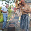 Stock Photo: Outdoor party - preparing shashlik