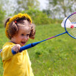 Little girl playing badminton — Stock Photo