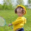 Little girl playing badminton — Stock Photo #5738277