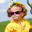 Cute funny little girl in sunglasses — Stock Photo