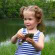 Fishing - littlle girl with catching fish - Stock Photo