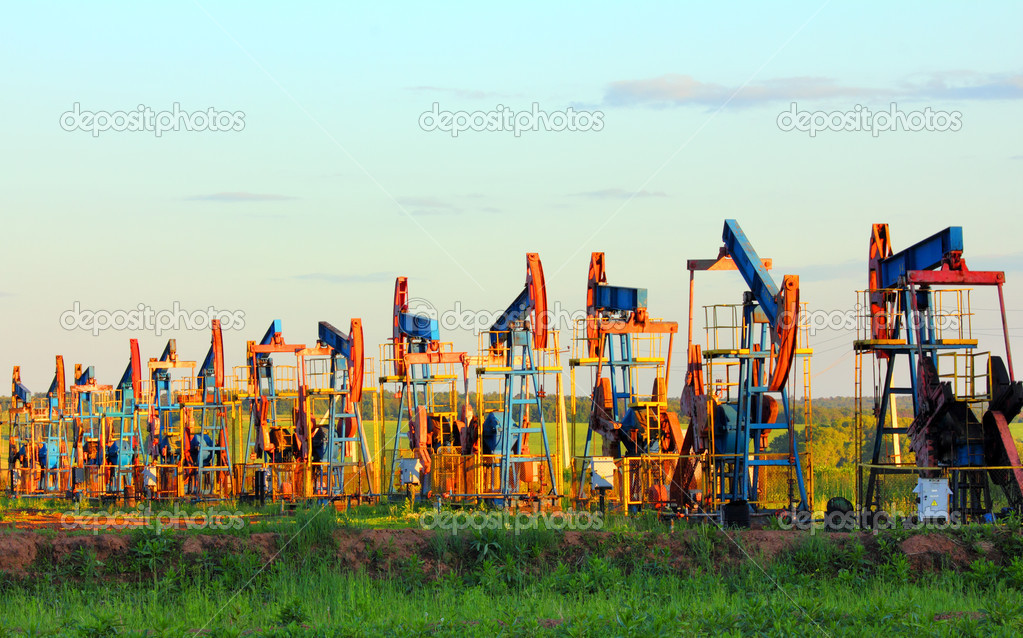 Many working oil pumps in row under blue sky — Stock Photo #5886125