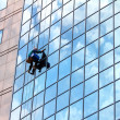 Window cleaner at work - Stok fotoğraf