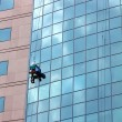 Window cleaner at work — Stock Photo