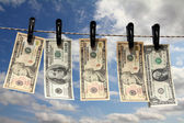 Paper dollars are drying on rope — Stock Photo