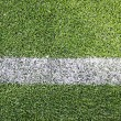 Green soccer/football field — Stockfoto