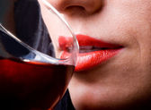 Red lips and glass of wine — Stock Photo