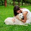 Girl and retriever in park — Stock Photo