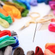 Embroidery floss and needle — Stock Photo #6054985