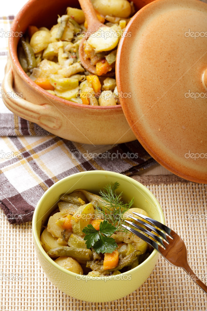 Stewed vegetables in pottery on table  Stock Photo #6164121