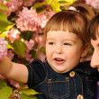 Mother and daughter in garden — Stock Photo