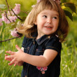 Little girl in garden — Stock Photo