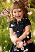 Little girl in garden — Stock Photo