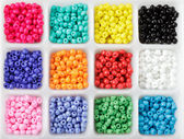 Beads in boxes — Stock Photo