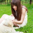 Stock Photo: Girl and retriever in park