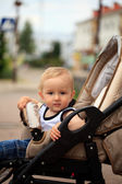 Toddler in baby carriage — Stock Photo