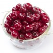 Bowl with ripe cherries. Isolated on a white background. — Stock Photo