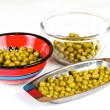 Green peas on a white background — Stock Photo