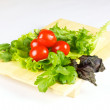 Fresh and juicy vegetables on the wood plate isolated - Stock Photo