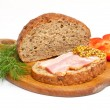Bread with ham, mustard, dill and tomato on the wood plate - Stock Photo