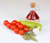 Red wine vinegar with fresh vegetables and spices — Stock Photo