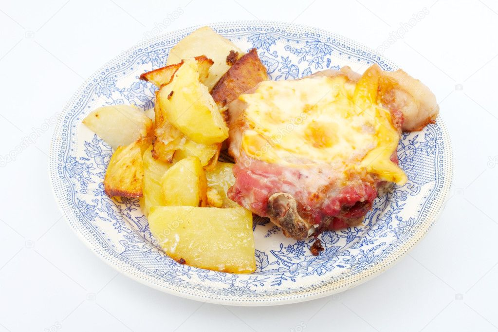 Grilled steak meat with cheese sauce and potatoes — Stock Photo #6339885
