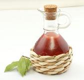 Vinegar bottle and laurel leaf — Stock Photo