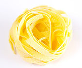 Dried italian pasta on white background — Stock Photo