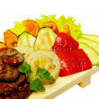 Grilled meat with fried vegetable salad — Stock Photo