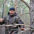 Man with a machete in the forest — Photo