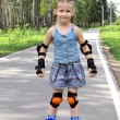 A girl on roller skates - Stock Photo