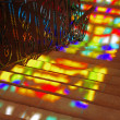 Spots of colored light on the stairs. - Stock Photo