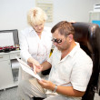 Doctor,examining a patient in ophthalmology clinic — Stock Photo