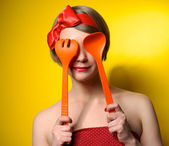 Pinup style housewife with kitchen utensils — Stock Photo