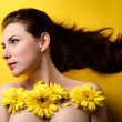 Topless woman covered with flowers — Stock Photo
