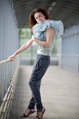 Young girl posing in a covered walkway — Stock Photo