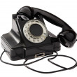 Old black vintage rotary style telephone — Stock Photo